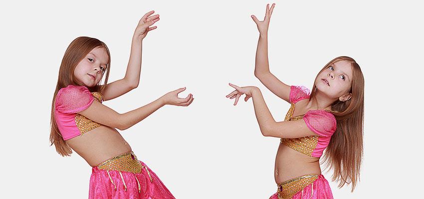 Девочка танцует танец bellydance